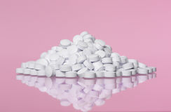 Stack of pills towards pink background Royalty Free Stock Photography