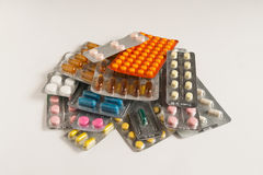 Stack of pills on a white background Stock Photos