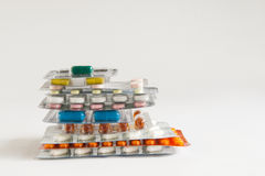 Stack of pills on a white background Stock Image