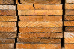 stack of pine boards on building materials warehouse Stock Photos