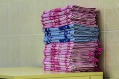Stack of pink bath towels close-up with blurred background Stock Images