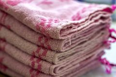 Stack of pink bath towels close-up with blurred background Stock Image