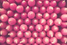 Stack of pink candles creates a pattern stock photography