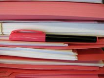 Stack of pink folders. And marker Royalty Free Stock Photography