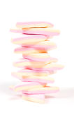 Stack of pink and yellow marshmallow. Isolated on white royalty free stock image