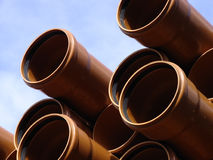 Stack of pipes. Stack of building pipes on the construct zone Stock Photo