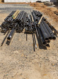 Stack of pipes on construction site Stock Photo