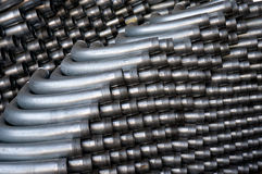 Stack of Piping. A tall stack of silver piping in a warehouse Stock Photos