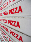 Stack of pizza boxes. Image of the stack of pizza boxes Stock Photography
