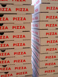 Stack of pizza boxes Stock Photos