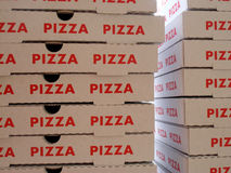 Stack of pizza boxes Royalty Free Stock Photos