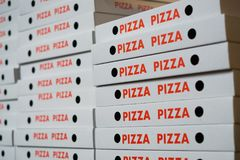 Stack of pizza boxes , many pizza cartons Royalty Free Stock Photo