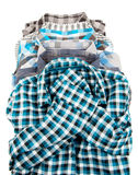 Stack of Plaid Long Sleeved Men's Shirts Stock Photos