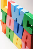 Stack of Plastic Alphabets Stock Image