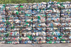 Stack of plastic bottles for recycling. On ground Royalty Free Stock Photos