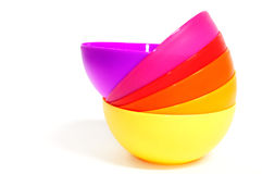 Stack of plastic bowls. In six different colors Stock Images