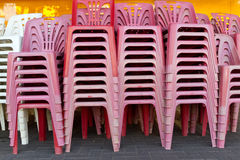 Stack of plastic chairs Stock Photos