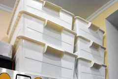 Stack of plastic storage boxes. Indoor closeup shot stock photo