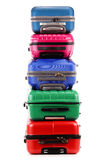 Stack of plastic suitcases on white Royalty Free Stock Photo
