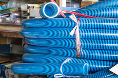 Stack of plastic Tubular Pipes. Close up of a stack of blue plastic tubular pipes Royalty Free Stock Photo