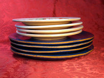 Stack of plates on red background Royalty Free Stock Photos