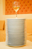 Stack of plates with wineglass Stock Image