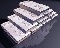 Stack of platinum bars. Stack of pure platinum bars on a reflective surface