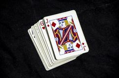 A stack of playing cards with a jack showing royalty free stock photo