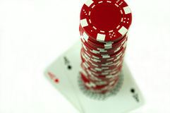 Stack of poker chips. On aces high Royalty Free Stock Images