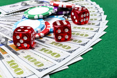 Stack of Poker chips with dice rolls on a dollar bills, Money. Poker table at the casino. Poker game concept. Playing a game Royalty Free Stock Photo