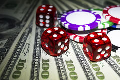 Stack of Poker chips with dice rolls on a dollar bills, Money. Poker table at the casino. Poker game concept. Playing a game Royalty Free Stock Image