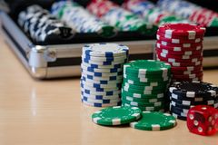 Stack of poker chips with it`s container case Royalty Free Stock Images