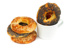 Stack of Poppy and sesame bagels with cup isolated Royalty Free Stock Photos