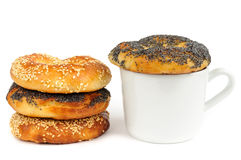 Stack of Poppy and sesame bagels with cup isolated Stock Image