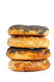 Stack of Poppy and sesame bagels on a white background Stock Image