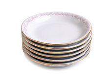 Stack of porcelain plates. Isolated on a white background Stock Photo