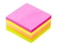 Stack of Postits. Stack of sticky post-it note pads, some bright, some pastel isolated on white background Royalty Free Stock Photos