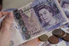 Stack of Pound Coins on Twenty Pound Notes Stock Image