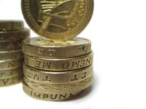 Stack of pounds. Two stacks of pound coins, shallow depth of field royalty free stock images