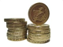 Stack of pounds. Stack of pound coins royalty free stock images