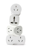 Stack of Power Adaptors. On White Background Stock Images