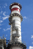 Stack of a power plant. Close view of the stack of a power plant against a cloudy blue sky Royalty Free Stock Photos