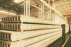 Stack of precast reinforced concrete slabs in a factory workshop stock image