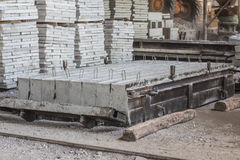 Stack of precast reinforced concrete slabs in a house-building factory workshop Stock Photography