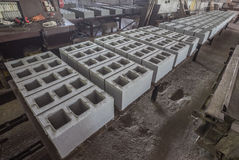 Stack of precast reinforced concrete slabs in a house-building factory workshop Stock Images