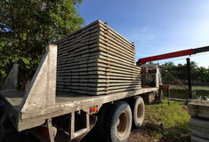 Stack of prestressed concrete slabs loaded on truck Royalty Free Stock Photo