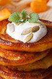 A stack of pumpkin pancakes with sour cream Royalty Free Stock Photo