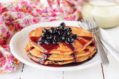 A Stack of Pumpkin Pancakes Topped with Chokeberry Preserves, copy space for your text Stock Photos