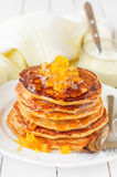 A Stack of Pumpkin Pancakes Topped with Pumpkin-in-Syrup Preserves. Copy space for your text Stock Image