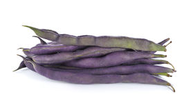 Stack of purple beans on white background Stock Photos